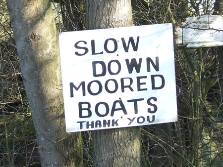 Please go past moored boats slowly