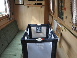 A travel cot on a  canal boat